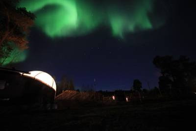 The Northern Lights in Extraordinary Settings